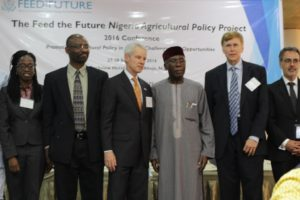 From Left to Right: IFPRI Director of the Development Strategy and Governance Division, Dr Paul Dorosh with the Honourable Minister for Agriculture and Rural Development, Chief Audu Innocent Ogbeh; Dr Hiroyuki Takeshima, Research Fellow, IFPRI; and Dr George Mavrotas, Chief Of Party of the Feed the Future Nigeria Agricultural Policy Project and Head of IFPRI Abuja Office.